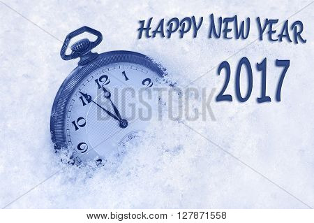 New Year 2017 greeting in English language, pocket watch in snow, happy new year 2017 text