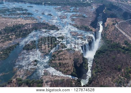 Victoria Falls from above in October. Waterfall running at low speed. Picture taken from helicopter.
