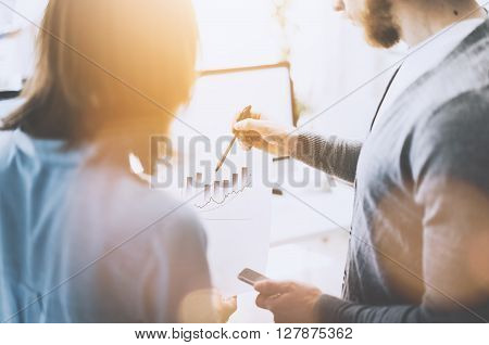 Business meeting image.Managers crew working with new startup project, discuss statistics document report.Idea presentation, analyze marketing plans.Blurred background, light and film effect
