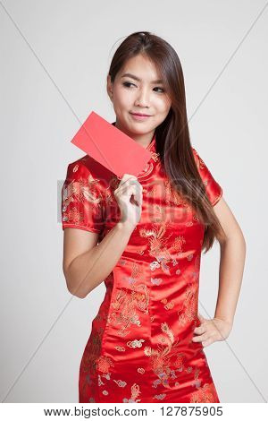 Asian Girl In Chinese Cheongsam Dress With Red Envelope
