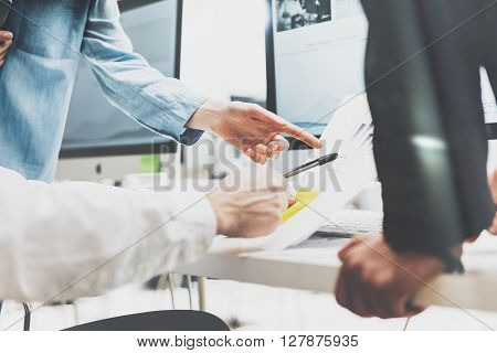 Business meeting brainstorming, photo documents holding hands. Photo account managers crew working with new startup project.Idea presentation, analyze marketing plans.Blurred, film effect,