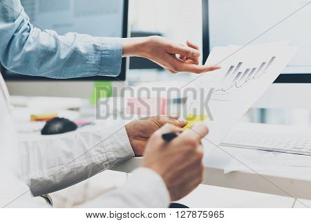 Business meeting, documents holding hands. Photo account managers crew working with new startup project.Idea presentation, analyze marketing plans.Blurred, film effect