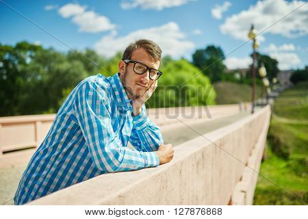photo of young hipster boy with glasses