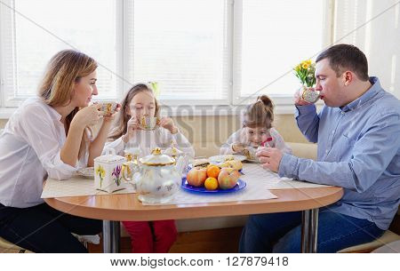 happy family has breakfast in the morning