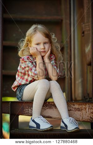 little beautiful girl with long hair posing