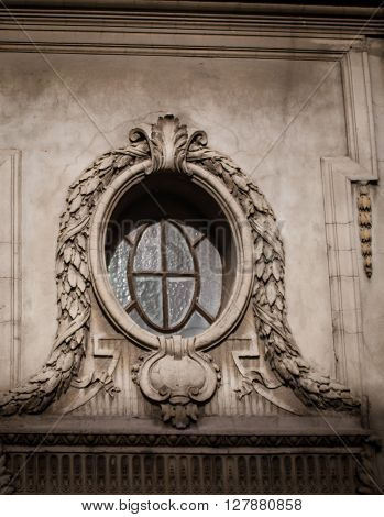 Ornate window above a doorway in Buenos Aires