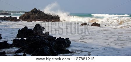 Morning Surf Breaks On Rocks Of Puako Beach