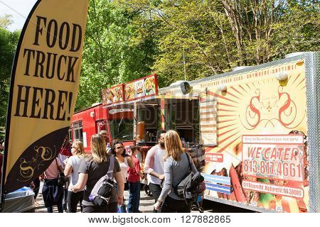 ATLANTA, GA - APRIL 2016:  A sign announces the presence of food trucks to a crowd attending the Food-o-rama festival in Grant Park in Atlanta GA on April 16 2016 .