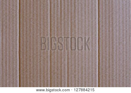 Close-up of an old light brown carton background