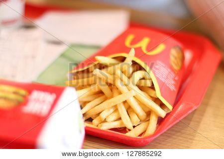 PERM RUSSIA - MAY 15 2015: French fries in McDonalds restaurant. McDonalds Corporation - US corporation large network of fast-food restaurants working on franchise system