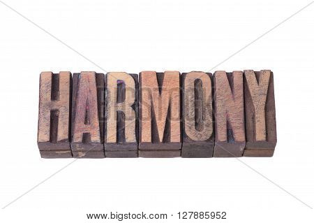 harmony word made from tilted wooden letterpress type isolated on white