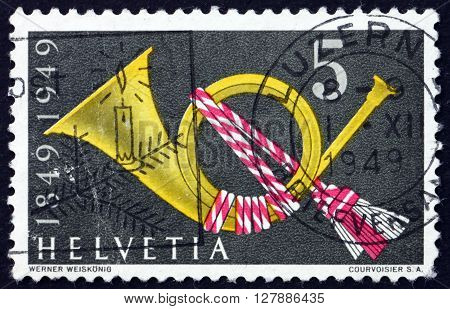 SWITZERLAND - CIRCA 1949: a stamp printed in the Switzerland shows Post Horn Symbol circa 1949