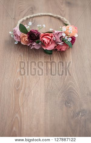 Pink Rose Flowers Wraith On Wooden Background