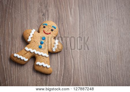 Gingerbread Man Cookie On Wooden Table