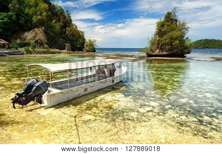 Wakai, Indonesia - Dec 14 2015: Beautiful tropical beach on Kadidiri island. Togean Islands or Togian Islands in the Gulf of Tomini. Central Sulawesi. Indonesia