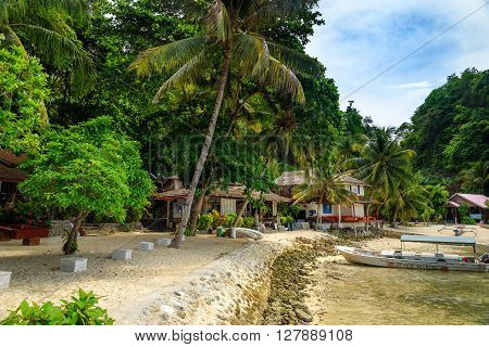 Kadidiri island Indonesia - Dec 15 2015: Beach near Black Marlin Dive Resort. Togean Islands or Togian Islands in the Gulf of Tomini. Central Sulawesi. Indonesia