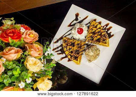Sweet waffles with chocolate sauce and ice cream chocolate on the table. Flat Lay in food.
