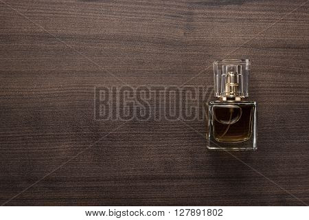 perfume bottle on the wooden table background