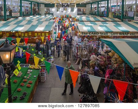 SHREWSBURY, UNITED KINGDOM - APRIL 30, 2016 - Indoor market at Shrewsbury Market Hall on a busy Saturday Shrewsbury, Shropshire, England, UK, Western Europe, April 30, 2016.