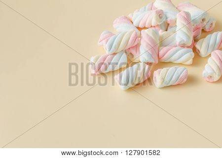 Colored Twisted Marshmallow On Beige Background
