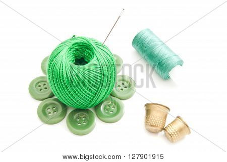 Thimbles, Needles And Green Thread On White