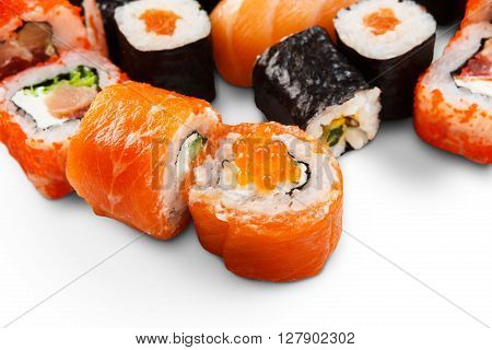Japanese food restaurant delivery - sushi maki california and salmon caviar roll plate or platter set isolated at white background. Closeup or macro shot.
