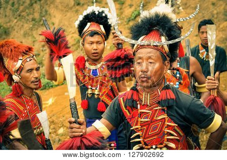 Mon Nagaland - April 2012: People in traditional costumes and large hats dance at Aoleang festival in Mon Nagaland. At this festival people can see indigenous dances and games and hear traditional songs. Documentary editorial.