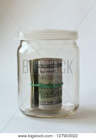 bundle of russian rubles in glass jar