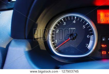 tachometer of modern car blur  focus  evening light