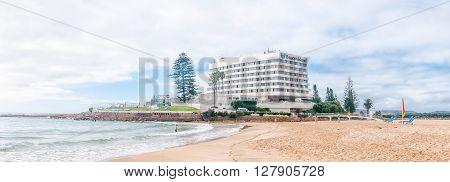 PLETTENBERG BAY SOUTH AFRICA - MARCH 3 2016: Unidentified tourists on a beach with a well known landmark a hotel in the back on Beacon Island