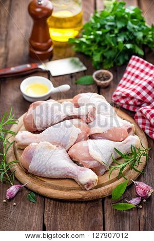 raw fresh chicken legs on wooden board