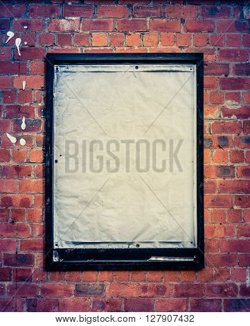 Grungy Blank Billboard On A Red Brick Wall