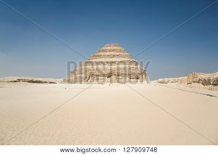 landscape of Egyptian desert with archeological area and Saqqara stepped Pyramid of Djoser from year 2648 Before Christ next to ancient Memphis city in Egypt Africa