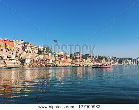 India, Varanasi, - March 7, 2015: Varanasi city landscape - view from the Ganga river, India, morning city river view, ancient city landscape