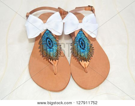 greek leather sandals with peacock feather, the symbol of goddess Hera