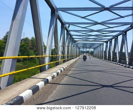 The highway and industrial bridge with the beautiful geometry of stripes