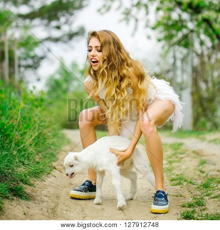 Young Woman With Goat