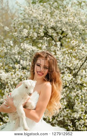 Sensual Woman With Small Goat