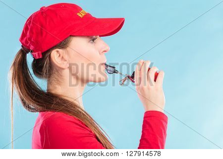Lifeguard Woman Blowing Whistle.