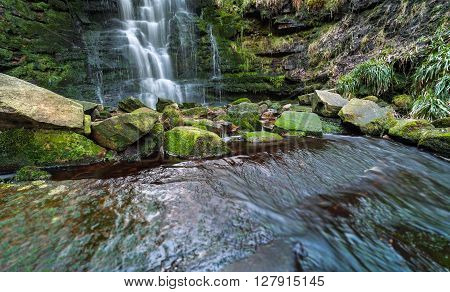 Clear Waterfall Cascade and Stones Covered in Green Moss