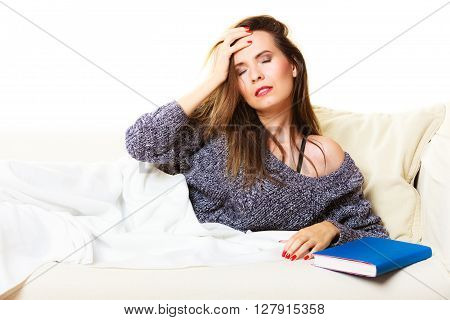 Health balance sleep deprivation concept. Woman lying on couch suffering from head pain taking power nap