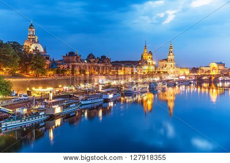 Scenic summer evening view of the Old Town architecture with Elbe river embankment in Dresden Saxony Germany