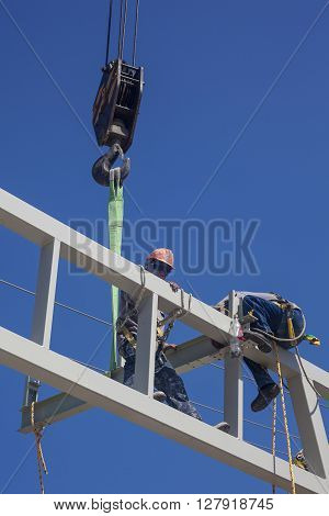 Men working at heights at a construction