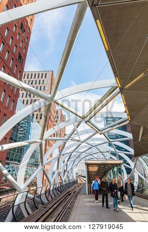 The Hague Netherlands - April 21 2016: Netkous viaduct at Beatrixkwartier with RandstadRail station and unidentified people. It is a modern construction designed by Zwarts & Jansma architects