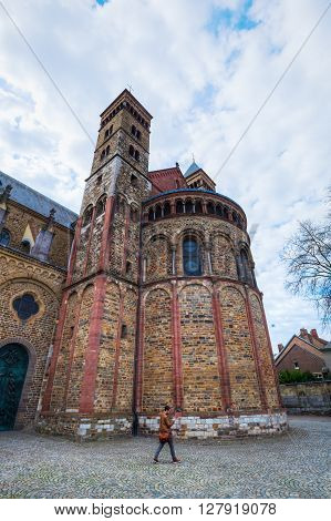 Maastricht Netherlands - April 11 2016: Basilica of Saint Servatius with unidentified people. The church is regarded as the oldest preserved church in the Netherlands
