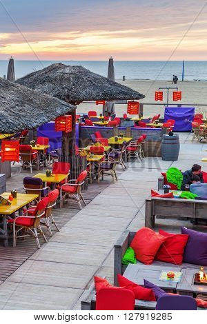 The Hague Netherlands - April 21 2016: beach bar at the beach of Scheveningen. Scheveningen is a district of The Hague and is famous for its long beach esplanade and pier
