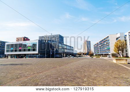 Heerlen Netherlands - April 11 2016: town square with the theater of Heerlen and unidentified people. Heerlen is a town in the Dutch province Limburg with about 90.000 inhabitants near the border to Germany