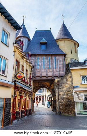 Valkenburg Netherlands - April 11 2016: medieval city gate and unidentified people in the old town of Valkenburg. Valkenburg aan de Geul in the province Limburg is a popular tourist destination