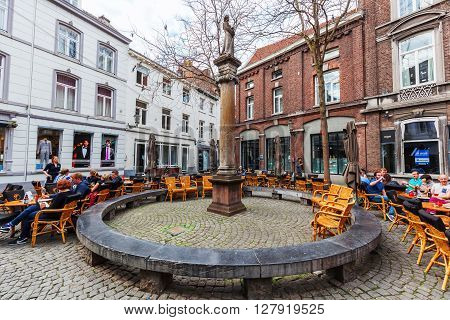 Maastricht Netherlands - April 11 2016: square with unidentified people in the old town of Maastricht. Maastricht is a university city and the capital of the Dutch province Limburg