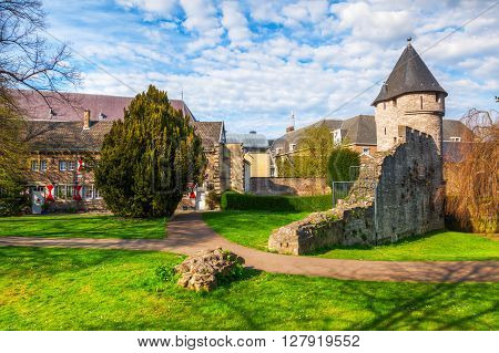 Maastricht Netherlands - April 11 2016: medieval city wall with unidentified people. Maastricht is a university city and the capital of the Dutch province Limburg
